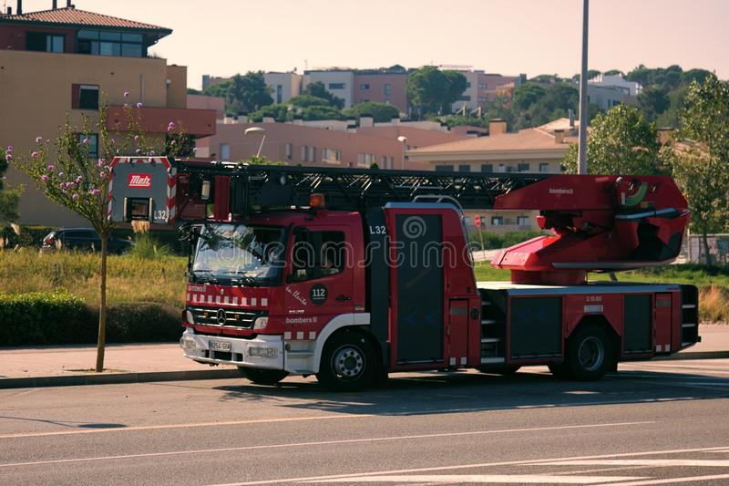 Spain firefighters special red-white colour. Spain, Leora de Mar - October 4, 2017: Spain firefighters special red-white colour, fire engine with extendable royalty free stock photography