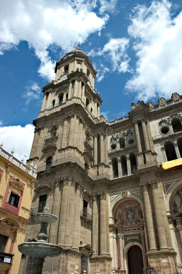 Spain, Malaga. A view of the Cathedral. Spain, the handsome city of Malaga. A view of the magnificent Cathedral on a winters day.  The bell tower stands high royalty free stock photos