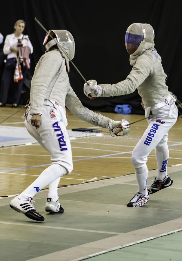 Fencing players competing word champion royalty free stock photo
