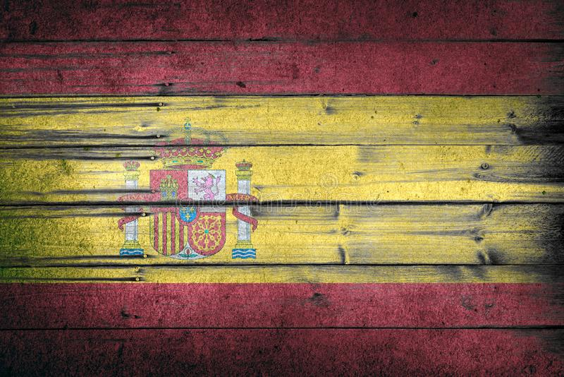 Spain national flag on wooden rustic background. Patriotism and world countries concept royalty free stock photography