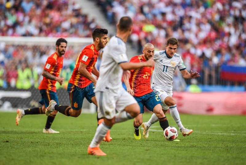 Spain national football team midfielder David Silva against Russia midfielder Roman Zobnin. Moscow, Russia - July 1, 2018. Spain national football team royalty free stock photo