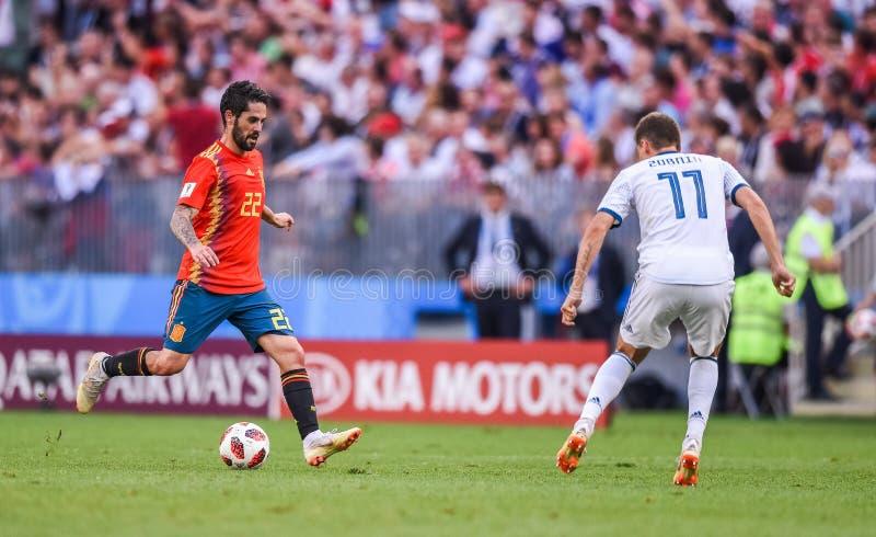 Spain national football team midfielder Isco and Russia national team midfielder Roman Zobnin. Moscow, Russia – July 1, 2018. Spain national football team royalty free stock images