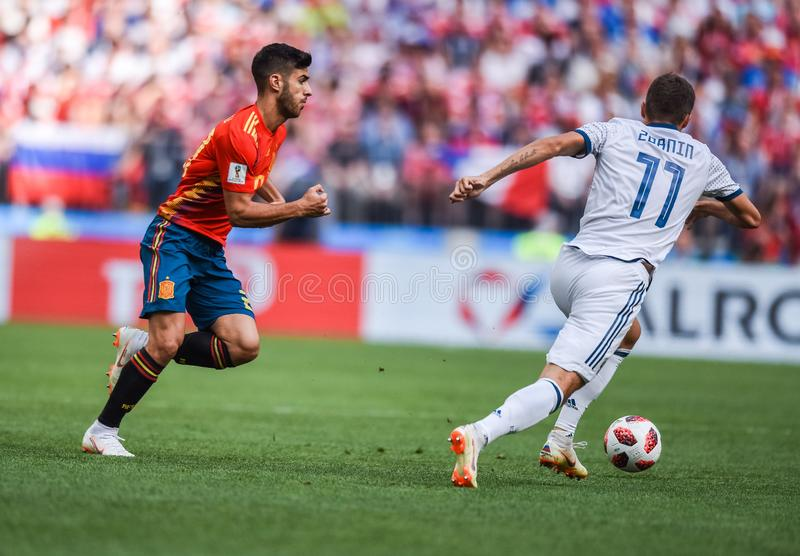 Spain national football team midfielder Marco Asensio against Russian player Roman Zobnin. Moscow, Russia - July 1, 2018. Spain national football team midfielder royalty free stock images