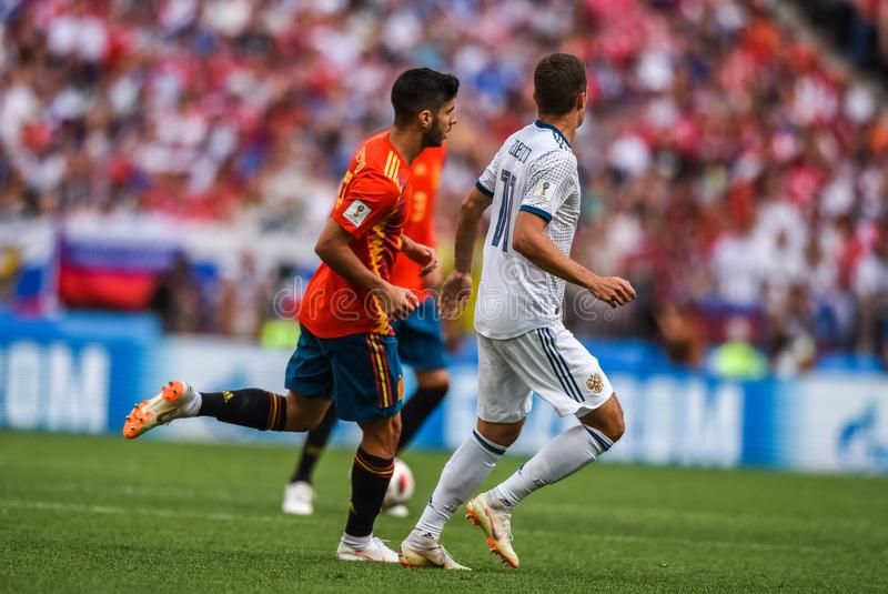 Spain national football team midfielder Marco Asensio and Russia midfielder Roman Zobnin. Moscow, Russia - July 1, 2018. Moscow, Russia - July 1, 2018. Spain stock photo