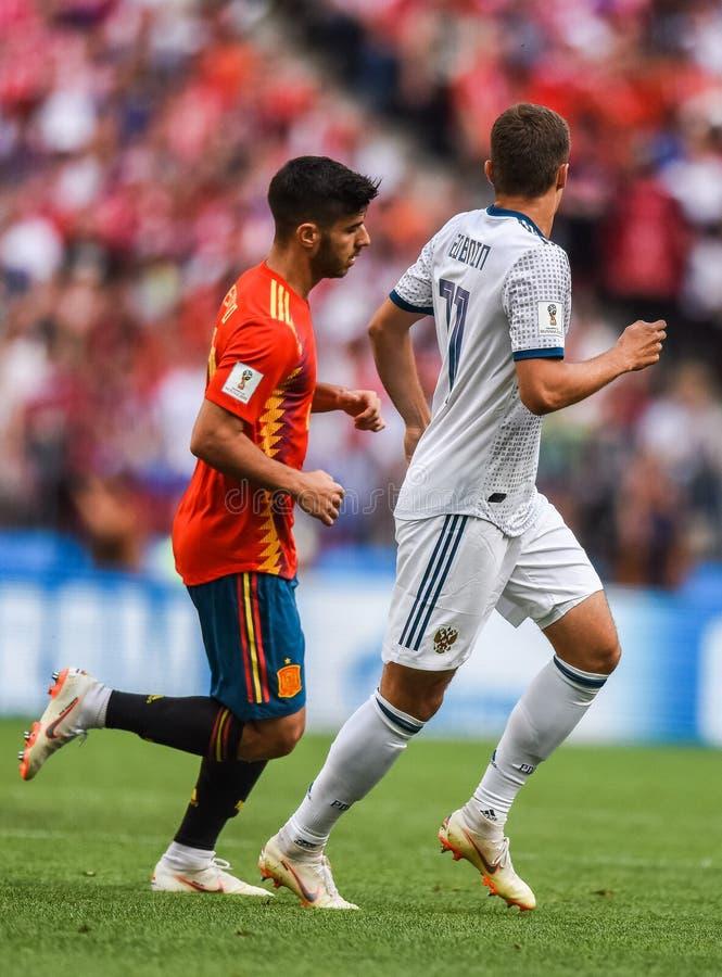 Spain national football team midfielder Marco Asensio and Russia midfielder Roman Zobnin. Moscow, Russia - July 1, 2018. Moscow, Russia - July 1, 2018. Spain royalty free stock photos
