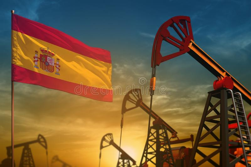Spain oil industry concept. Industrial illustration - Spain flag and oil wells against the blue and yellow sunset sky background. Spain oil industry concept royalty free stock image
