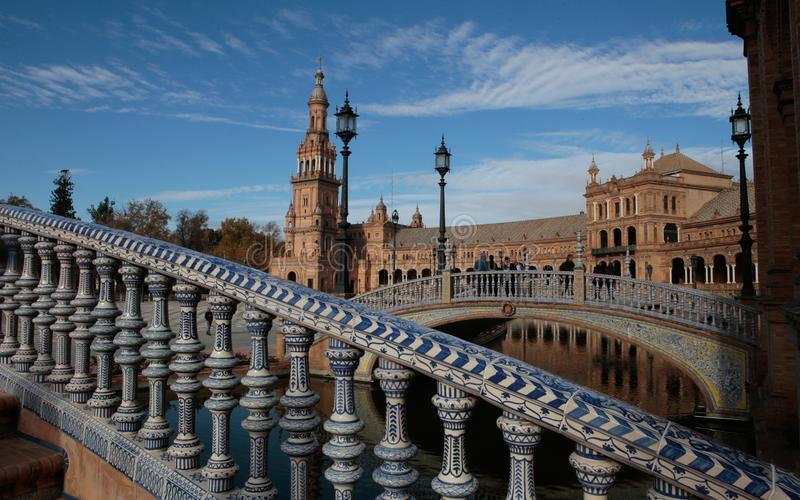 Spain plaza square in Seville. Spain Square is a plaza in Seville, Spain, It is a landmark example of the Regionalism Architecture, mixing elements of the stock photography