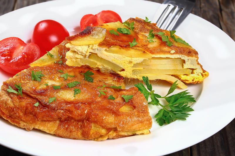 Spain potato omelet tortilla cut in slices stock photo