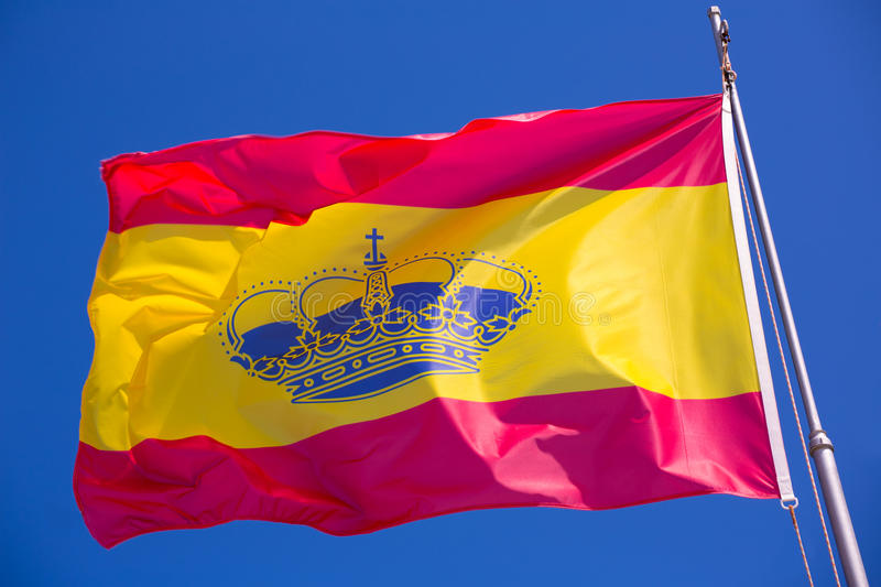 Spain red and yellow flaw waving on wind. Under blue sky royalty free stock images