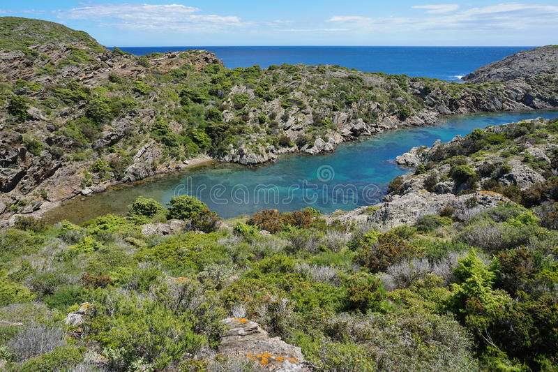 Spain small cove clear water Mediterranean sea. Spain coastal landscape small cove with clear water, Mediterranean sea, Cala Bona in the Cap de Creus natural stock photography