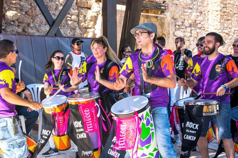 SPAIN-TORREVIEJA, CONCERT ROCK AGAINST CANCER - JUNE 16, 2018: Bateria of Young People Drum Percussion Tambourines Capoeira stock photo