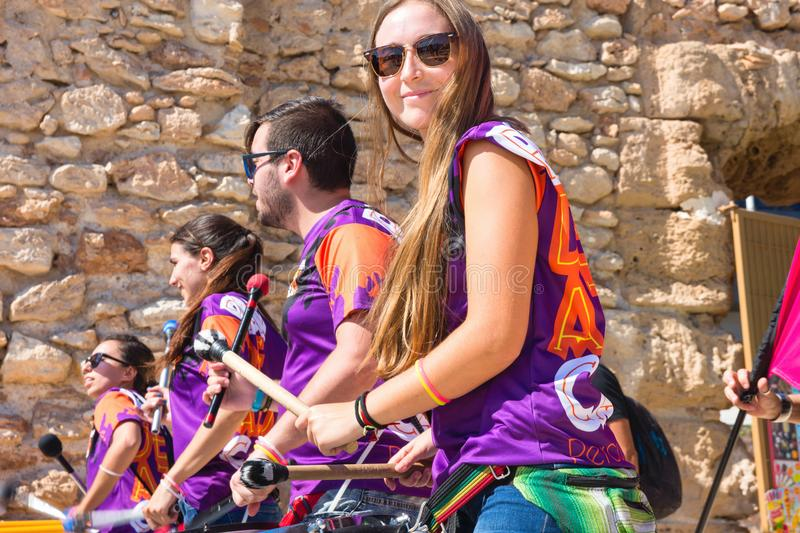 SPAIN-TORREVIEJA, ALICANTE, JUNE 16, 2018 Cheerful Laughing Young People Drum Percussion Tambourines Capoeira Rhythm royalty free stock photo