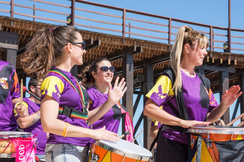 SPAIN-TORREVIEJA, ALICANTE, ROCK AGAINST CANCER - JUNE 16, 2018 Laughing Young People Drum Percussion Tambourines Capoeira Rhythm royalty free stock image