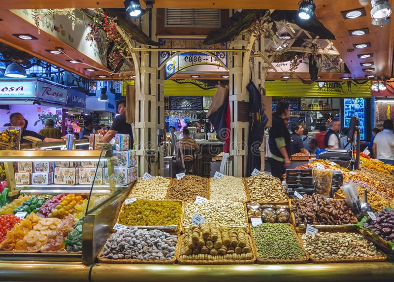 SPAIN, VALENCIA - OCT 16, 2018 : Dried Fruit shop in Central Market of Valencia Famous market place in old town crowd People royalty free stock images