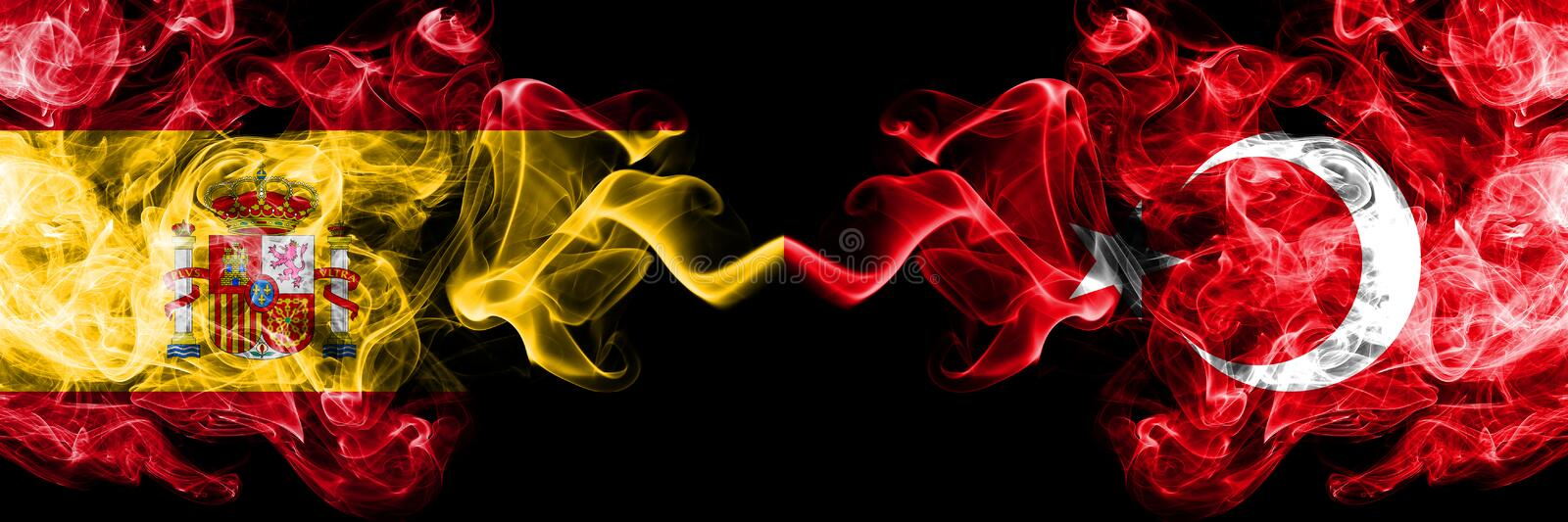 Spain vs Turkey, Turkish smoky mystic flags placed side by side. Thick colored silky smokes flag of Spanish and Turkey, Turkish. Spain ,vs Turkey, Turkish smoky stock photo