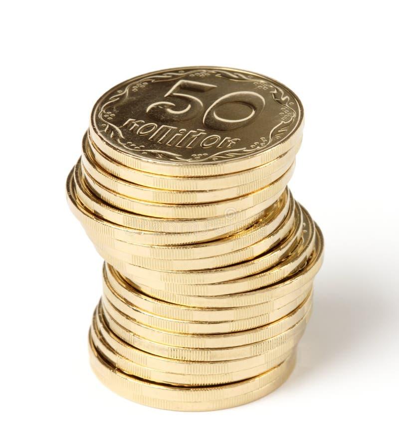 Spalte von goldene Münzen stockbild
