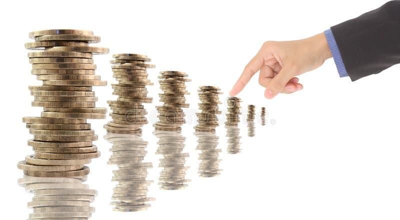 Spalten der Münzen getrennt auf Weiß stockbild
