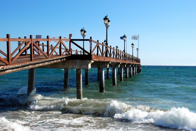 Wooden seaside pier, Marbella, Spain. royalty free stock photo