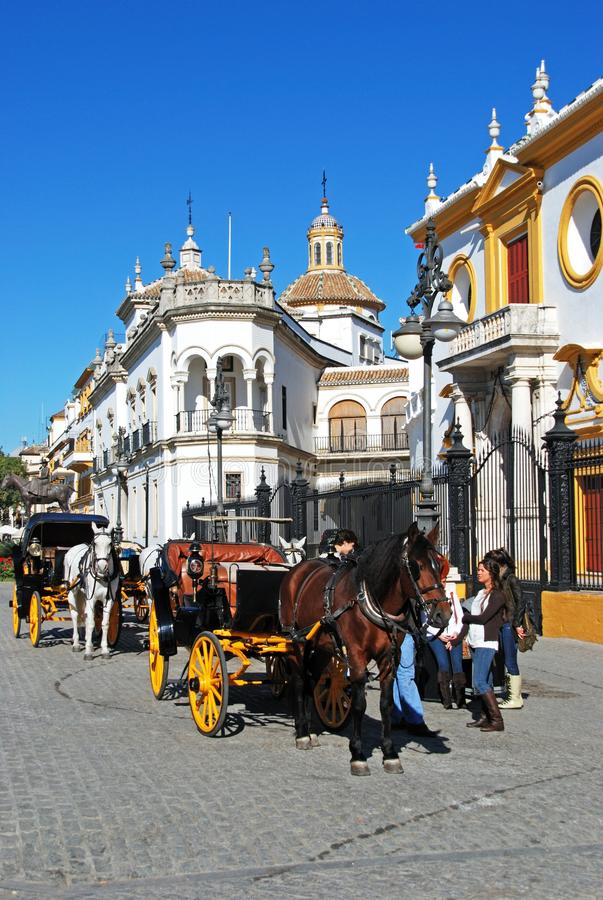Horse drawn carriages by the bullring, Seville, Spain. royalty free stock photography