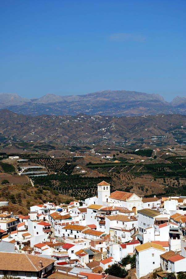 White village and mountains, Iznate, Spain. View of whitewashed village and surrounding countryside, Iznate, Malaga Province, Andalucia, Spain, Western Europe royalty free stock photo
