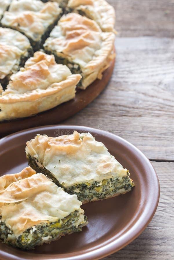 Spanakopita - греческий пирог шпината стоковые изображения rf