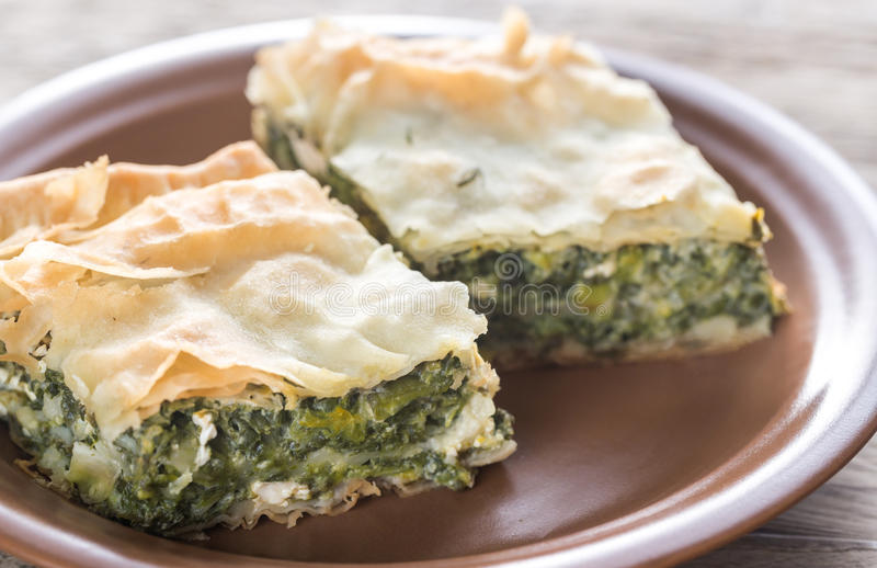 Spanakopita - Greek spinach pie. On the plate stock photo