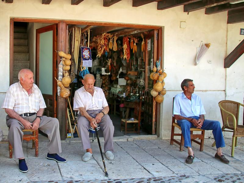 Spanish People Spaniards. Spaniards standing in front of a local market in Chinchon, Spain stock image