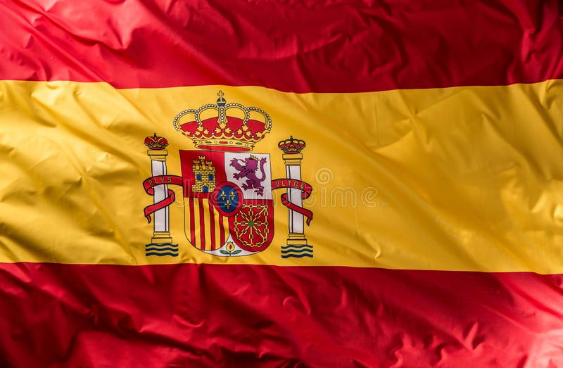 Spanien-Flagge der Seide Spanische nationale Farben mit Emblem stockbild