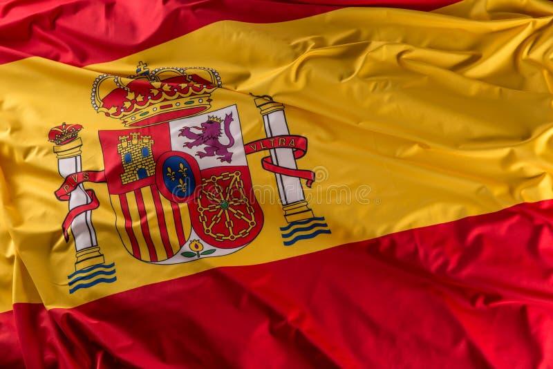 Spanien-Flagge der Seide Spanische nationale Farben mit Emblem stockbilder