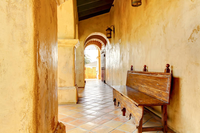 Spanish building details with arches and bench. stock photo