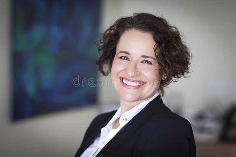 Spanish Businesswoman Smiling At the Camera. At the office. royalty free stock photo