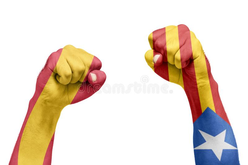 Spanish and Catalan flag painted in the hand with a fist. Referendum stock photography