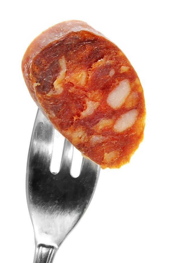 Spanish chorizo. Red spanish chorizo on a white background royalty free stock images