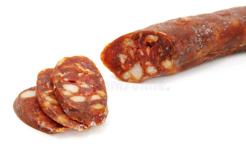 Spanish chorizo. Red spanish chorizo on a white background stock photo