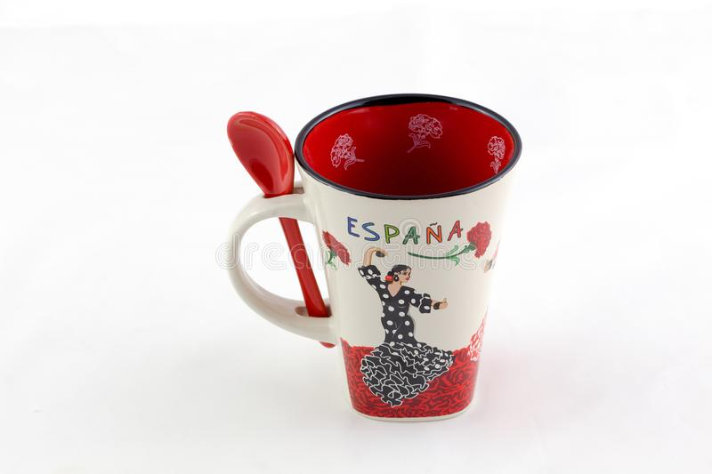 Spanish coffe cup and small spoon, souvenir for tourists. royalty free stock images