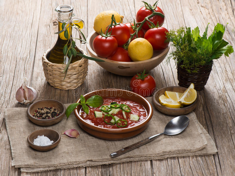 Spanish cold tomato based soup gazpacho served in a clay plate stock photos