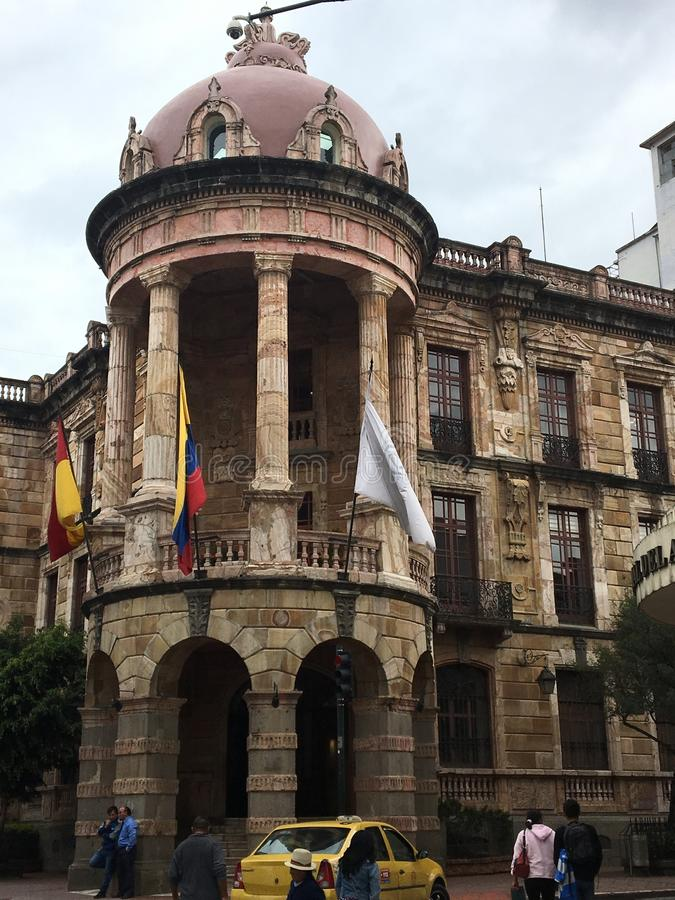 Historic Building with Rotunda, Cuenca Ecuador. Spanish colonial architecture facade. Rotunda with columns and arches. Balustrade and wrought iron details royalty free stock image