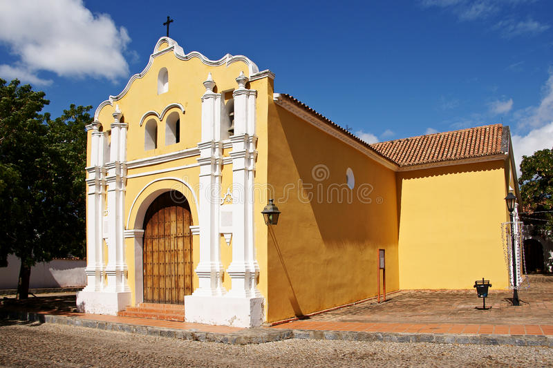 Spanish colonial style church. And street in the historic town of Coro, Falcon State, Venezuela. UNESCO heritage site stock image