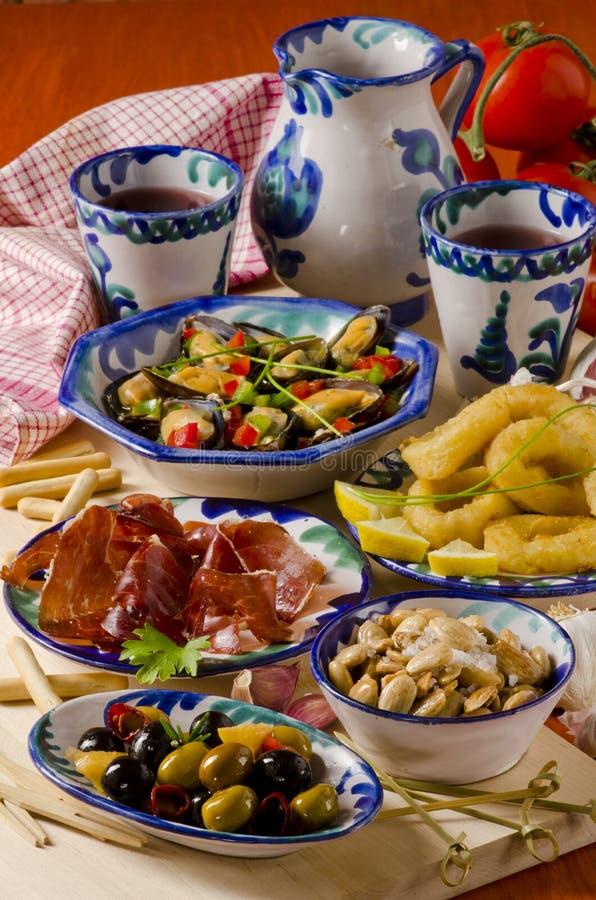 Spanish Cuisine. Assorted Tapas On Ceramic Plates. Stock Photo