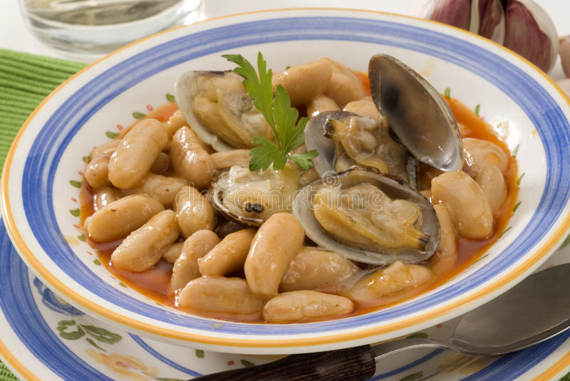 Spanish Cuisine. Asturian clams and beans. royalty free stock photography