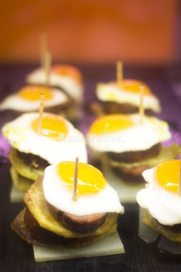 Spanish cuisine egg tapas dishes in restaurant stock photo