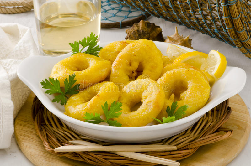 Spanish Cuisine. Fried Squid Rings. Calamares a la Romana. royalty free stock photos