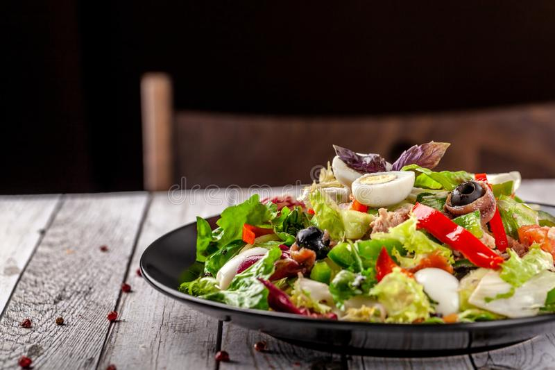 Spanish cuisine. Mixed salad fish salad, red and green Bulgarian pepper, quail eggs, canned mackerel, olives, seasoned with oil. Spanish cuisine. Mixed salad stock images