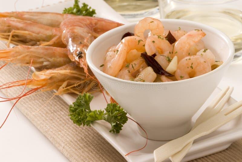 Spanish cuisine. Shrimps in garlic sauce. royalty free stock photo