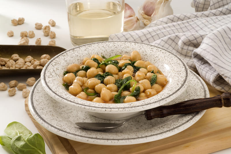 Spanish Cuisine. Spinachs with chickpeas. Spanish Cuisine. Garbanzos con espinacas. Spinachs with chickpeas. Selective focus stock image
