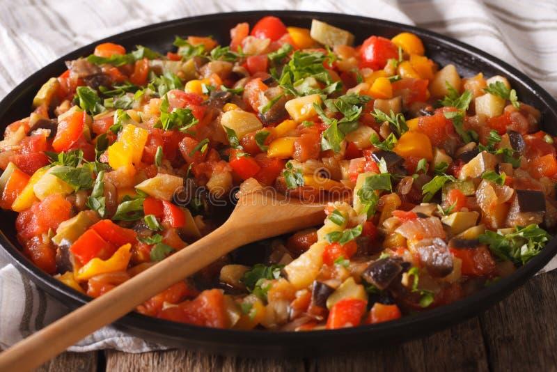 Spanish cuisine: vegetable stew Pisto manchego macro on a plate. Spanish cuisine: vegetable stew Pisto manchego macro on a plate on the table. Horizontal royalty free stock image