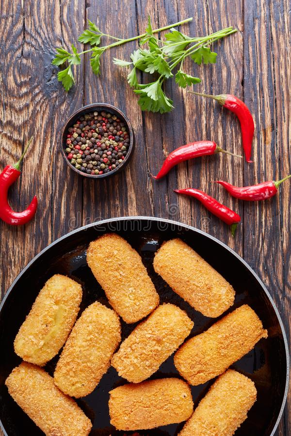 Spanish deep-fried potato croquettes, top view royalty free stock images
