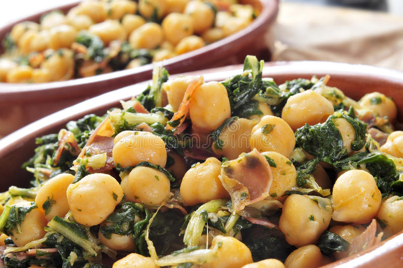 Spanish espinacas con garbanzos, spinach with chickpeas, served. As tapas stock photo