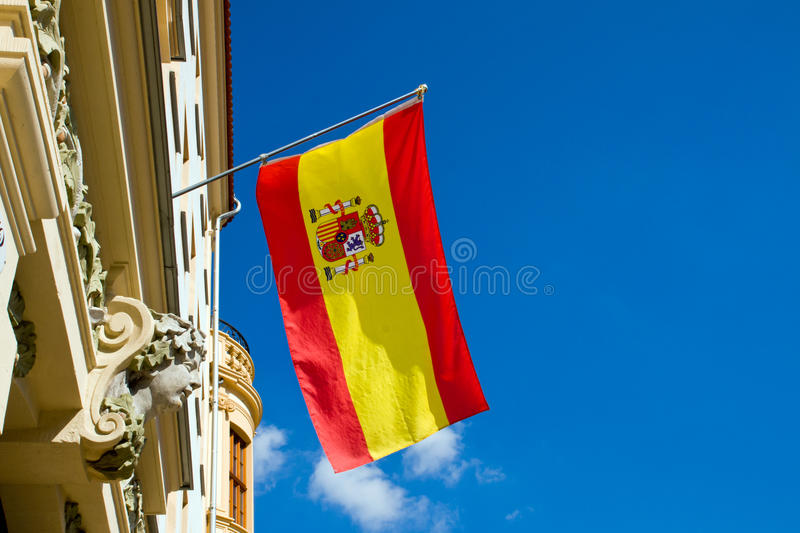 Spanish flag flying at an old building stock images