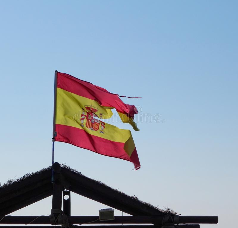 Spanish Flag. In heavy wind could be seen as a symbol of a Spain in crises with part who want to split of from Spain royalty free stock photography